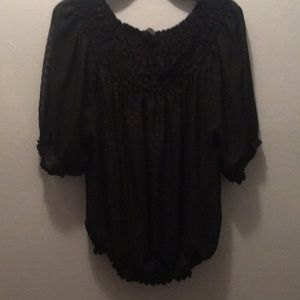 Black blouse with elastic button.